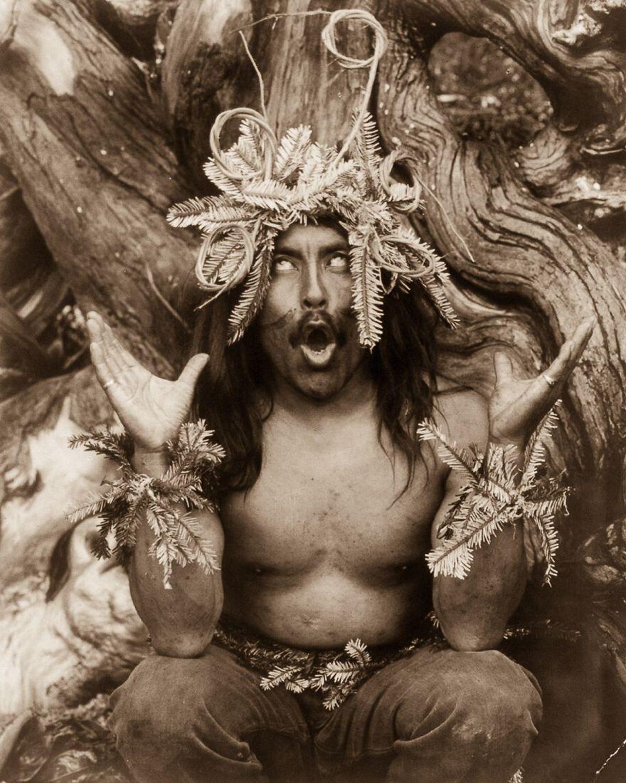A Kwakiutl shaman performs a religious ritual, 1914