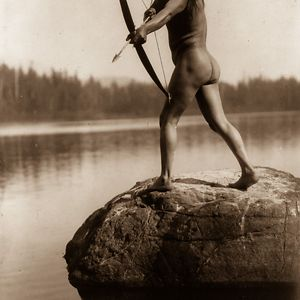 A Nootka Man Aims A Bow And Arrow, 1910