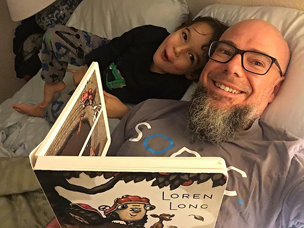 Single Dad's And Son's Book Ritual Before Bed Time