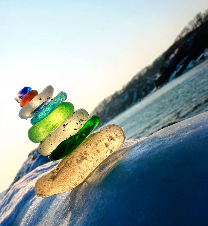 vodka-bottle-pebbles-glass-beach-ussuri-bay-russia-5