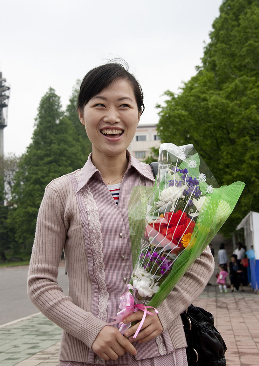 Woman With A Bunch Of Flowers In Pyongyang, North Korea