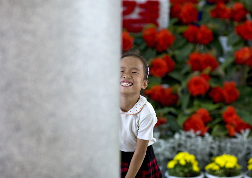 Little Girl In The International Kimilsungia And Kimjongilia Festival, Pyongyang, North Korea
