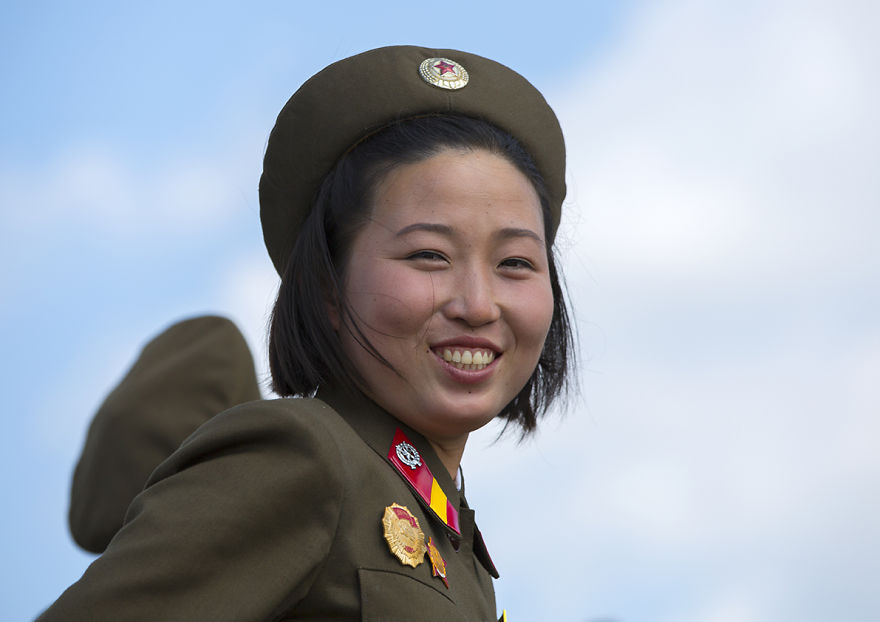 Smiling Female Soldier In Tower Of The Juche Idea, Pyongyang, North Korea
