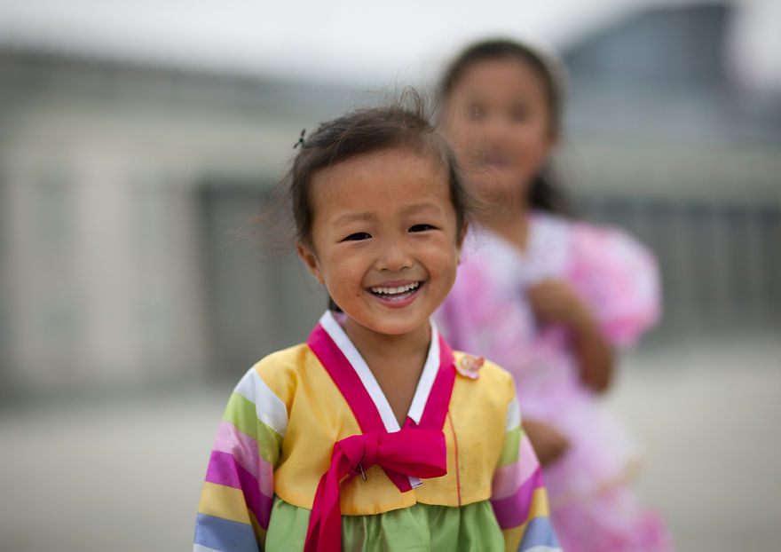 Young Girl In Traditional Dress Smiling, Pyongyang, North Korea