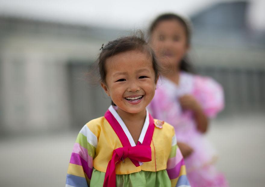 Young Girl In Traditional Dress Smiling, Pyongyang, North Korea