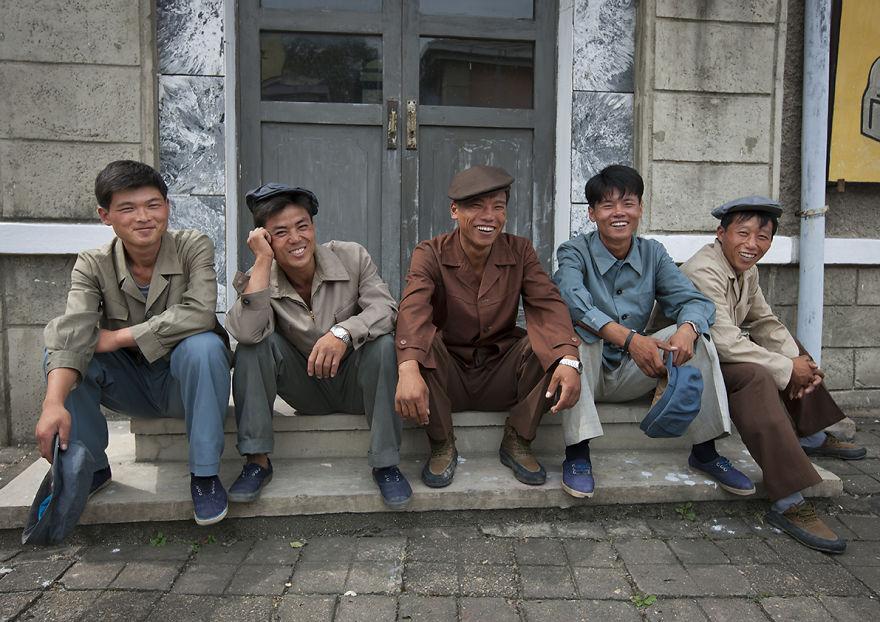 Actors Sitting On Steps And Smiling At Pyongyang Film Studio, North Korea