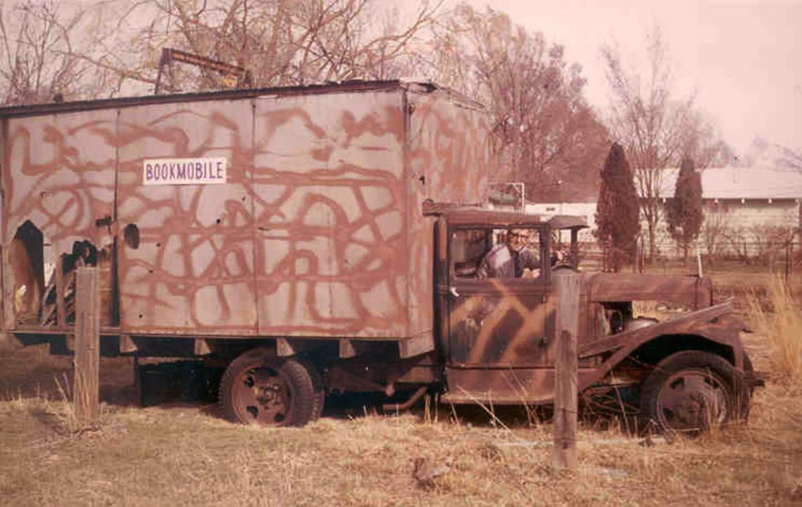 "Paul Buttars, Former Manager Of The Utah State Library Bookmobile Program, In One Of The ""older"" Bookmobiles. Taken In Chesterfield, Ut, C.1975"