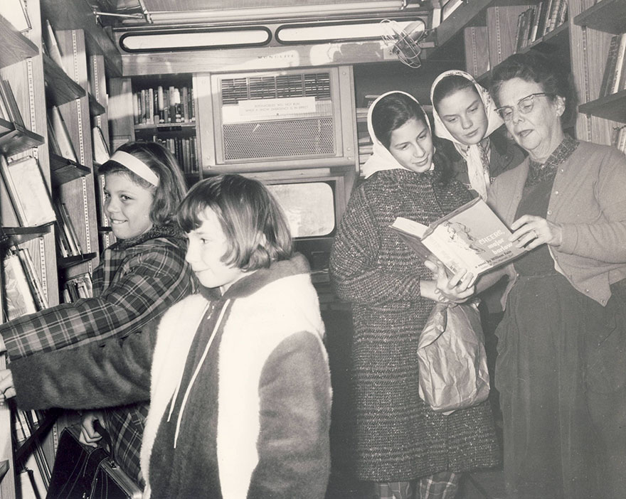 Patrons Visit The Bookmobile In 1962. Mrs James B. Wilson, Librarian, Performs Readers' Advisory Service At Far Right