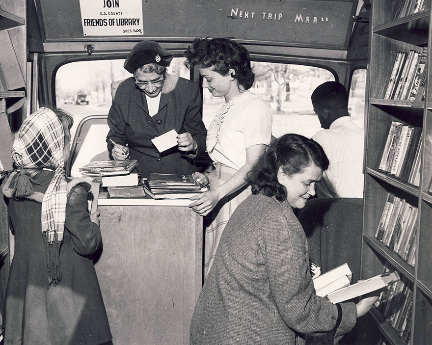 Carolyn Herntz Assists Patrons Visiting The Bookmobile, 1958