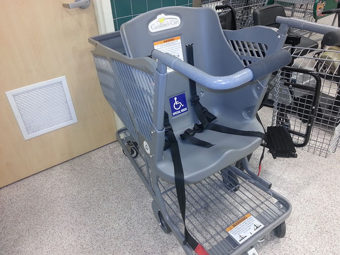 This Grocery Cart Lets You Push Around Special Needs Adults Instead Of Children