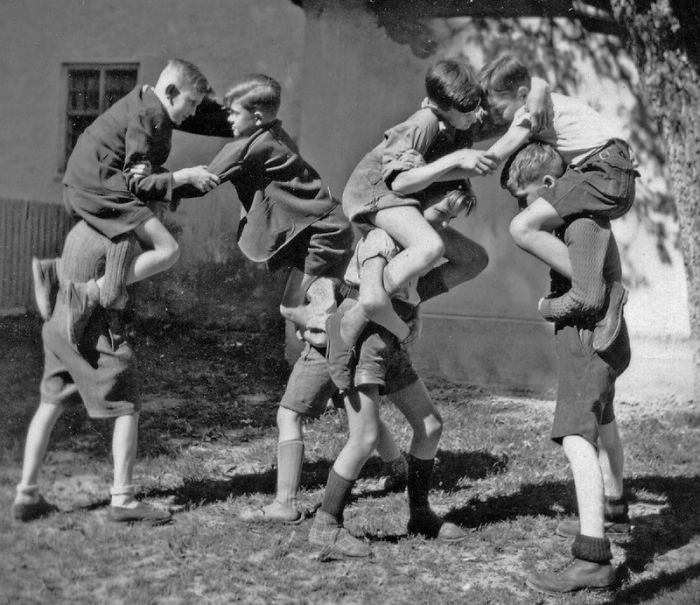 A Group Of Boys Aged Between 8 - 14 Out At Play