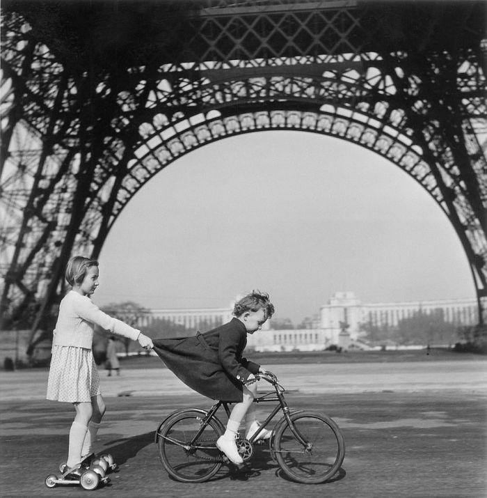 Children Playing In Paris Under The Eiffel Tower