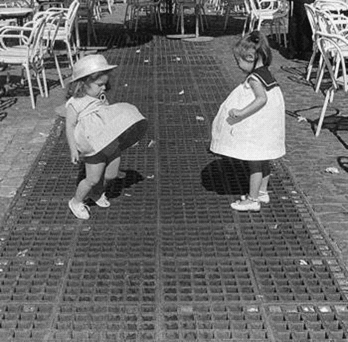 Girls Playing With Their Skirts On An Air Vent