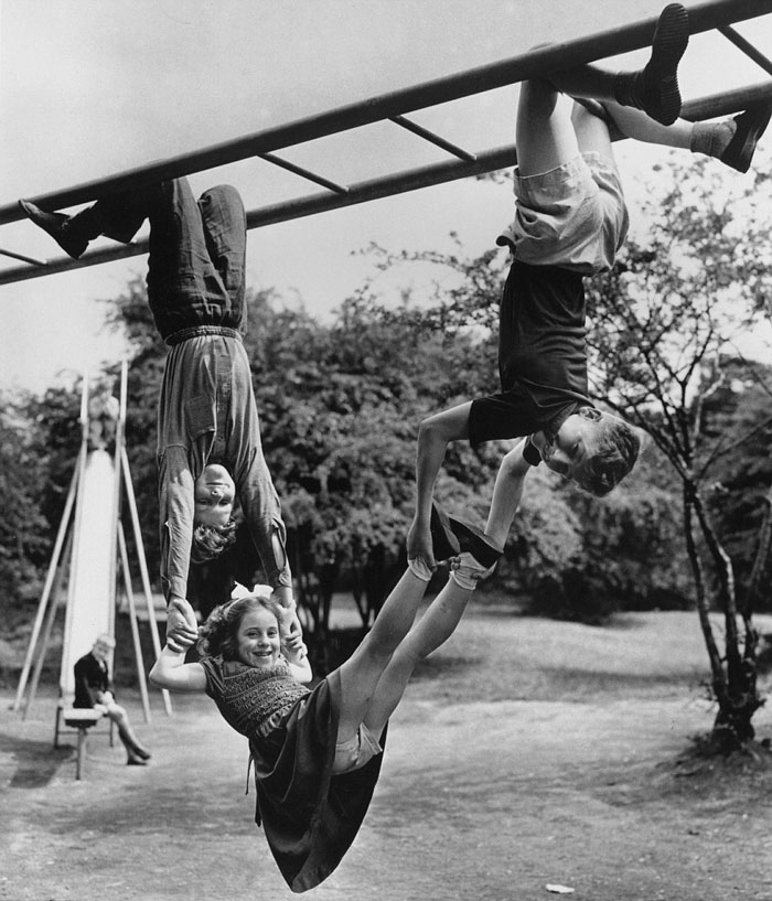 This Girl From Finchley, North London, Shows No Fear Of Being Dropped By Her Two Friends As They Play, 1954