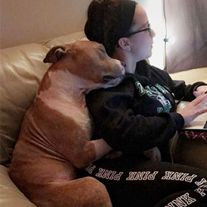 Woman Adopts A Pitbull, And The Dog Can't Stop Hugging Her