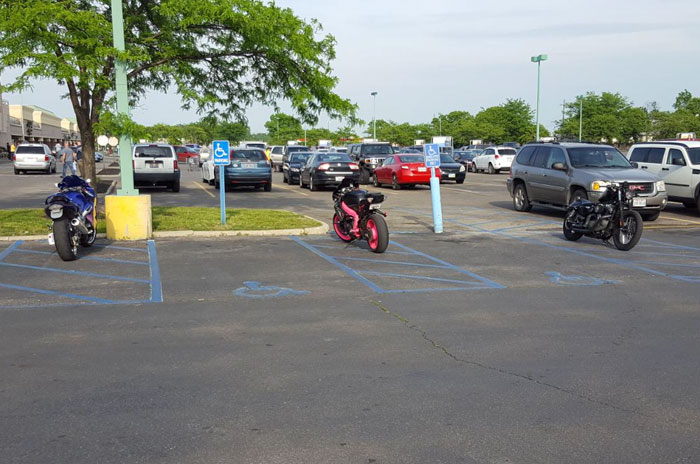 The Stripes Next To Handicap Spots Are Not Motorcycle Parking