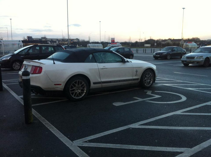 In A Nearly Empty Car Park, The Only Mustang In Ireland Taking Up Not Only One, But Two Disabled Parking Spots