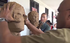2 Artists Sculpting Each Other