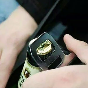 Use The Metal Part Of Your Seat Belt To Open Beers While Driving