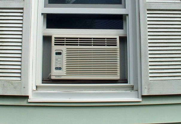 Reverse Your Window A/C Unit Like So To Save On A Costly Heating. It's Also Good For The Environment Because It Cools The Outside, Reducing Global Warming
