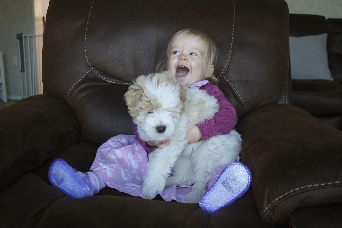 My Daughter Holding Her Puppy For The First Time.
