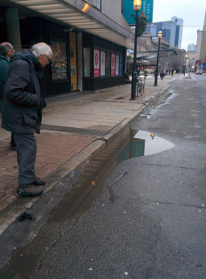 I Was Taking A Picture Of A Puddle In Toronto Until I Was Approched By Two Different Strangers And This Happened…