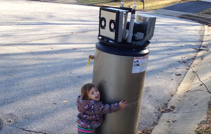 Little Girl Falls In Love With Abandoned Water Heater Thinking It's Robot, And It's Hilariously Adorable