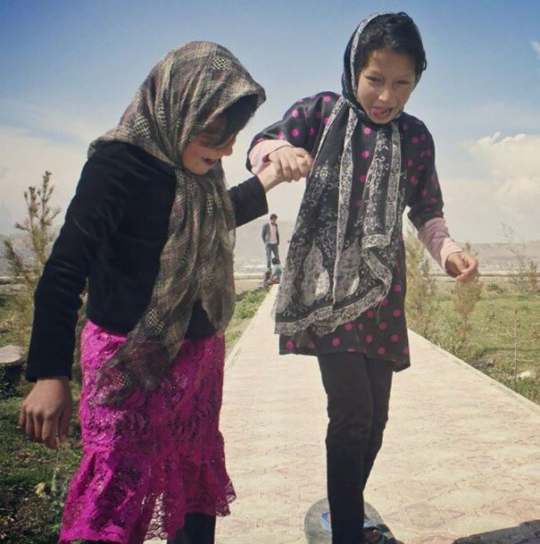 Two Girls Skateboarding For The First Time In Kabul