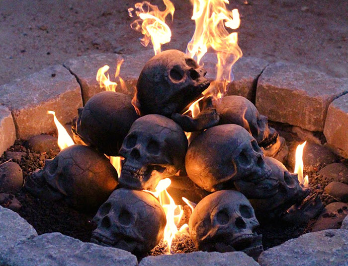 Terrifying Fireproof Human Skull Logs For Your Next Family Camping Trip