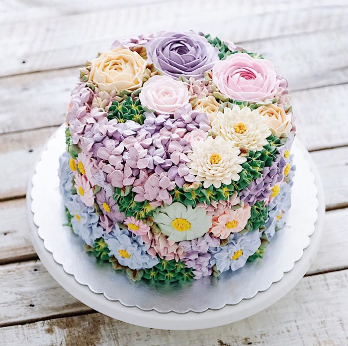 10 blooming flower cakes to celebrate the return of spring bored spring colourful buttercream flower cakes mightylinksfo Images