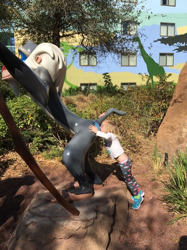 "At Disney, Daughter Said ""Mom Take A Picture Of Me Giving Rafiki A Kiss"""