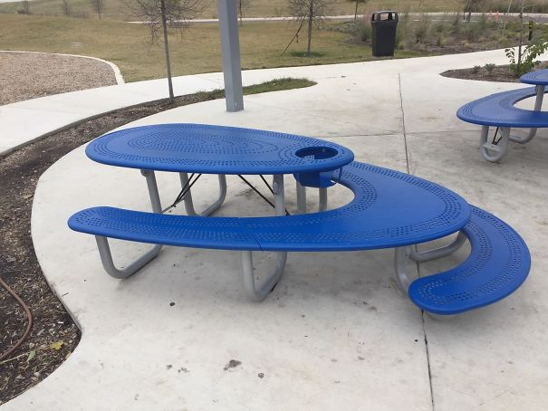 This Picnic Table Has Seating For Adults, Seating For Small Children, A High Chair And Space For Wheelchair Users