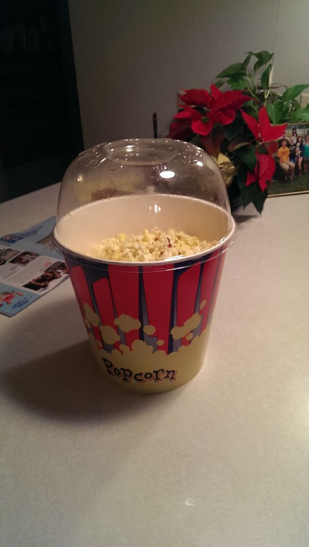 This Theater Has A Cool Popcorn Bucket With A Lid On It To Use While Shaking It To Coat It And To Use As A Bowl