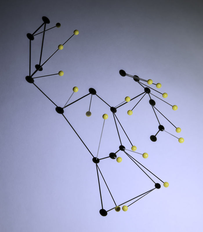 A Photograph Of The Orion Constellation, Using Pins And Shadows