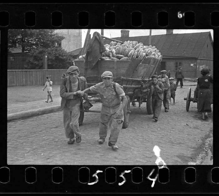 1942: Men Hauling Cart For Bread Distribution