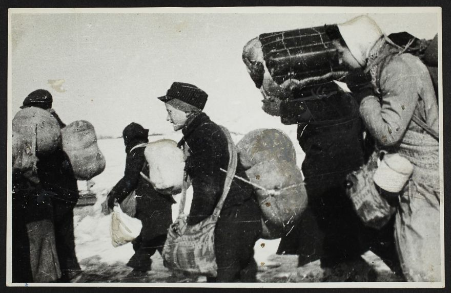1944: A Boy Walks Among A Crowd Of People Being Deported In Winter