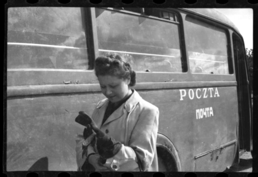 1940-1944: Woman Posing With A Mail Truck