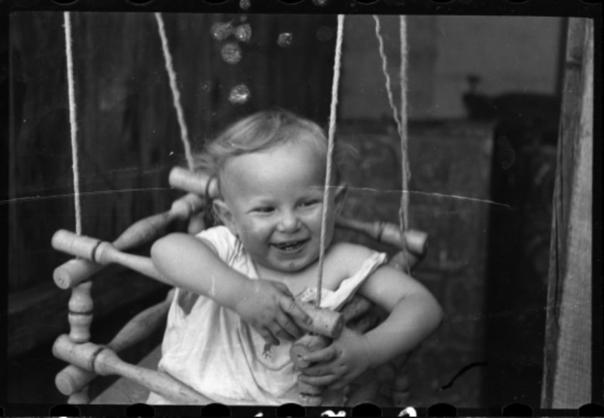 1940-1944: A Boy In A Doorway Swing