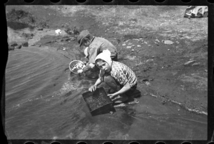 1940-1944: Children In Pond Searching For Items To Salvage