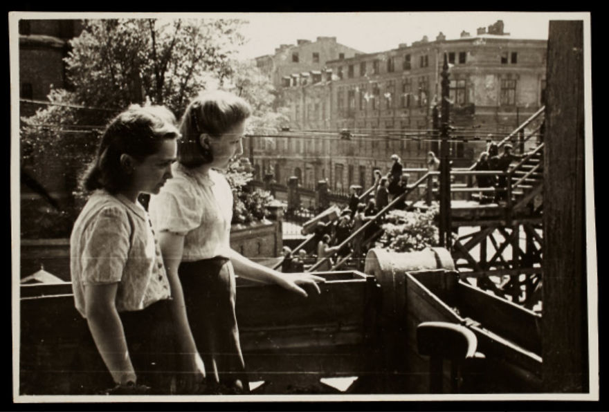 1940-1944: Two Young Women Observing The Bridge At Koscielyn Square, Crossing Zigerska Street