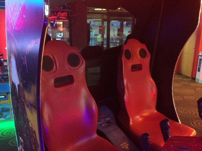 Scared Couple In A Thriller Game Machine