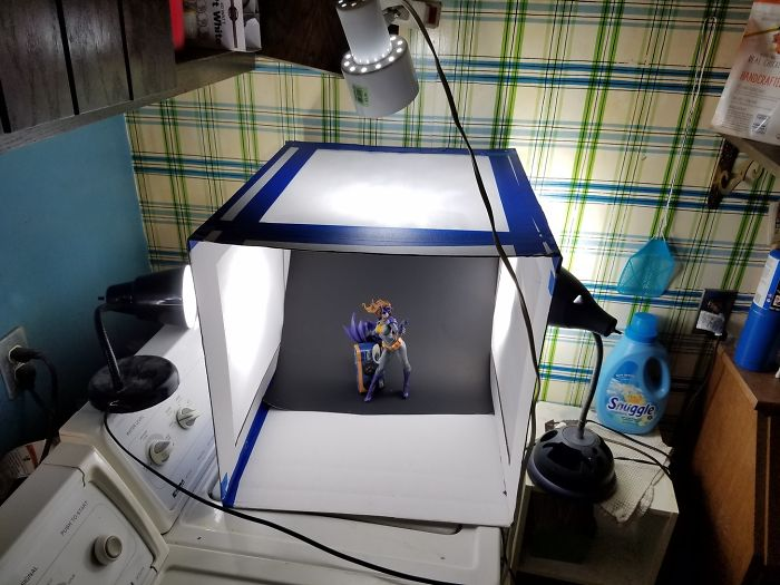 Some Pizza Boxes, Blue Painters Tape, Construction Paper – $6 Photo Booth