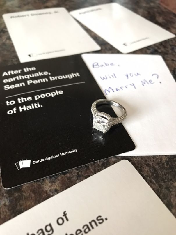 surprise marriage proposal and pregnancy announcement during cards