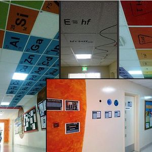 Hallway In A High School That Has A Periodic Table And Other Science Formula On Ceiling.