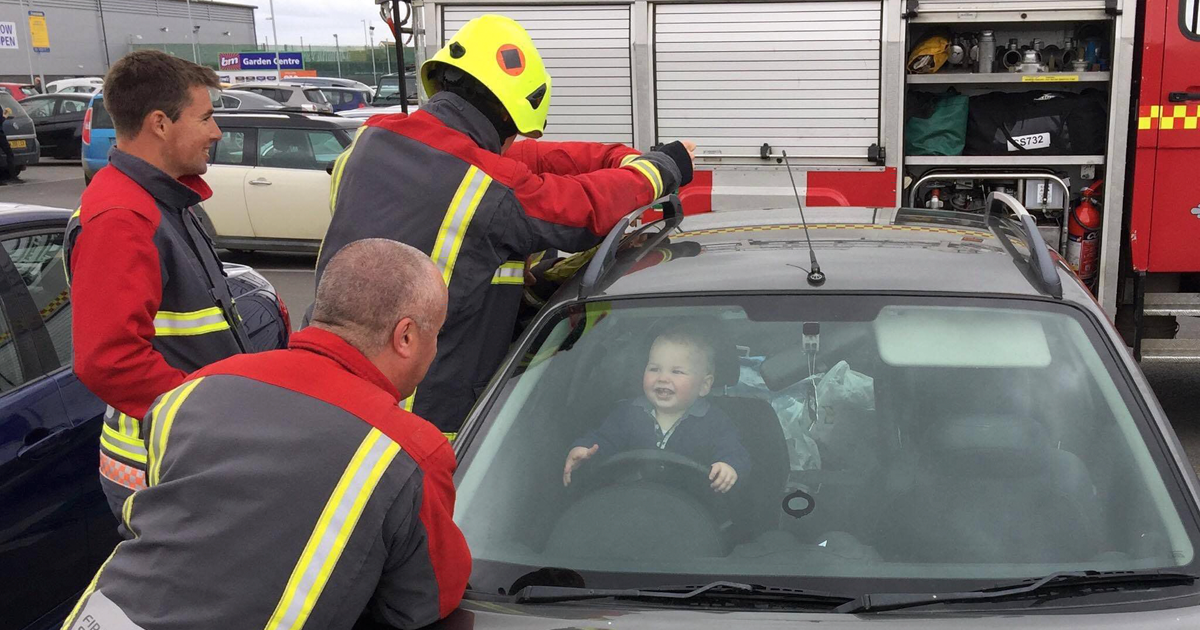 Toddler Can't Stop Laughing After Locking Himself In Car While 5 Firefighters Try To Rescue Him