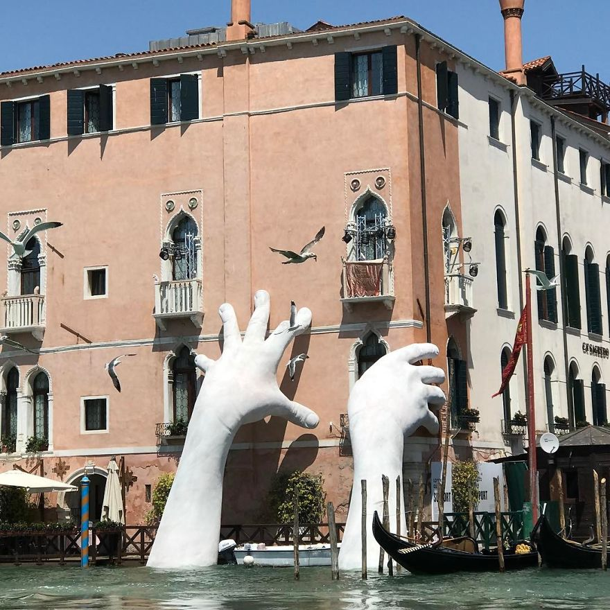 Support: Giant Hands Rise From A Canal In Venice To Send A Powerful Message About Climate Change