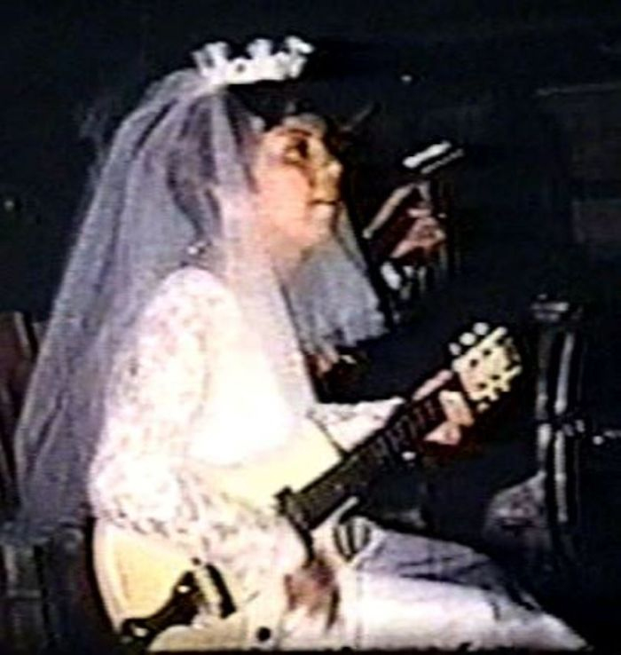 My Mother, Jeanette, Playing Guitar At Her Own Wedding In 1966.  She Said The Band Sucked So She And Her Band Played For The Crowd Instead. They Were Called Little Jeanie And The Caravan.