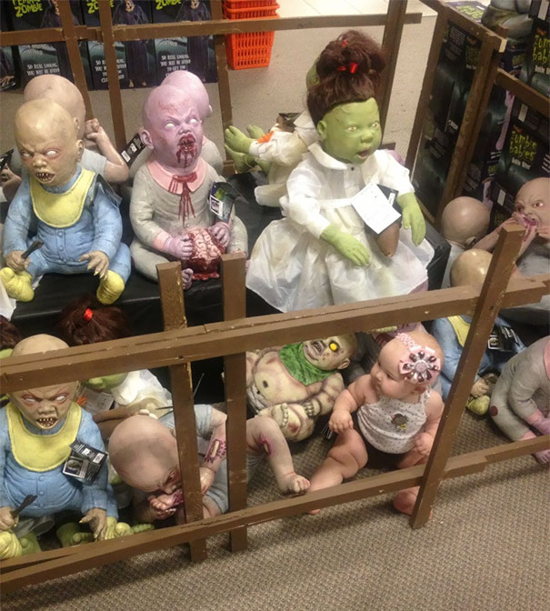 My Friend Decided To Put Her Baby With All The Zombies At The Halloween Store