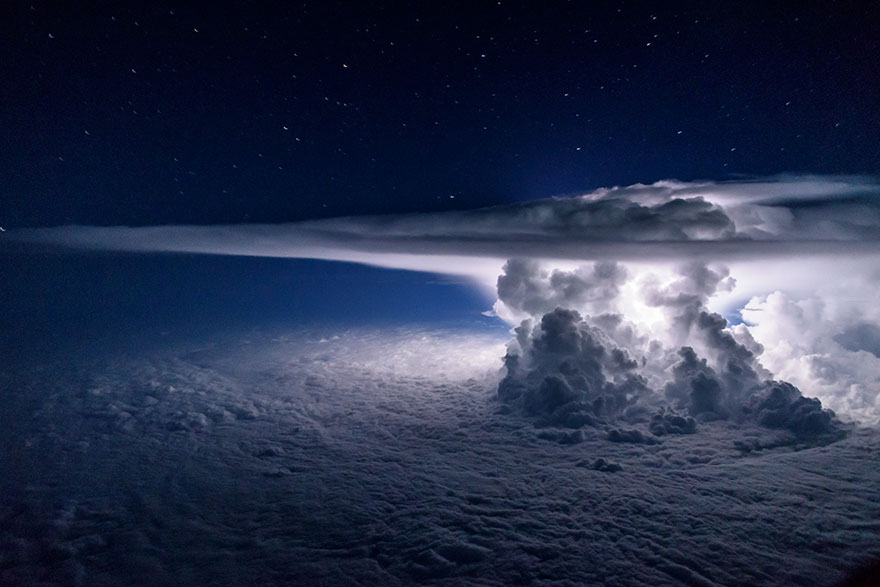 'A Colossal Cumulonimbus Flashes Over The Pacific Ocean As We Circle Around It At 37000 Feet En Route To South America'