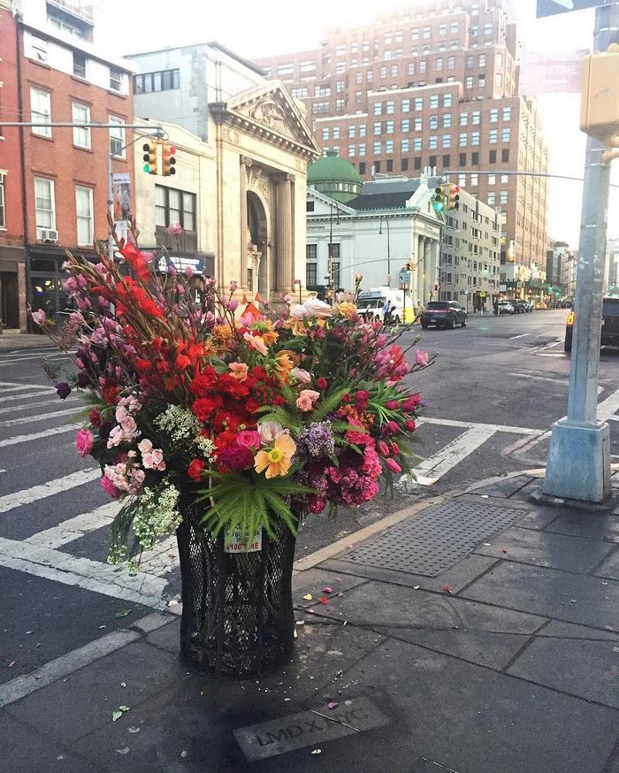 Crime Or Art Someone Is Turning NYC Trash Cans Into Giant Vases - Artist turns nyc trash cans into giant flower filled vases